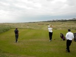 Nick hitting a shot at Royal Dornoch as Uncle Steve and I look on