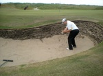 Nick blasting one out of the same bunker to about 10 feet (you can see my ball in the background)